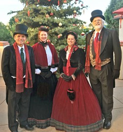 VICTORIAN MOTIF! The Uncommonne Carolers, (left to right) Craig Updegrove, Karla Santare, Meagan Glimpse, and Chuck Hiigel, perform everything from church hymns to modern popular holiday songs arranged both simply and in more complicated jazz and classical styles. - PHOTO COURTESY OF LINDA A. WILSON