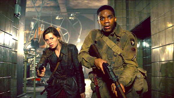 WHERE'S PAUL? French freedom fighter Chloe (Mathilde Ollivier, left) with the help of U.S. soldier Boyce (Jovan Adepo) go in search of Chloe's little brother, who's been taken to a Nazi laboratory where local villagers are being experimented on. - PHOTOS COURTESY OF BAD ROBOT