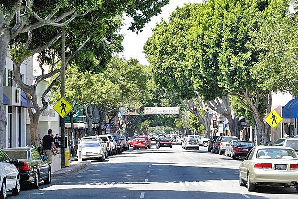 CARS GALORE SLO (pictured), Pismo Beach, and Paso Robles are all eyeing new parking policies and projects to address a crunch for spaces. - FILE PHOTO BY STEVE E. MILLER