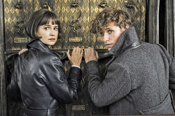 DO YOU BELIEVE IN MAGIC? Tina Goldstein (Katherine Waterson, left) and Magizoologist Newt Scamander (Eddie Redmayne) team up to battle evil wizard Gellert Grindelwald. - PHOTO COURTESY OF WARNER BROS.