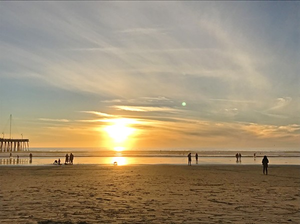 GOLDEN HOUR There's nowhere else I can feel so simultaneously at peace and inspired than on the Pacific Ocean shore. Here's Pismo Beach at sunset, after a long walk down the coast. - PHOTO BY PETER JOHNSON