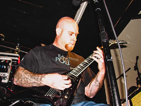 SHREDDER Known for his technical proficiency, Erik R. Lindmark (pictured) also fronted local metal band Charlie Christ. Two other local metal bands—Cryptolith and Stone Mountain—will play his celebration of life on Dec. 20, in Sweet Springs Saloon. - PHOTO COURTESY OF GISELE KINGSTON