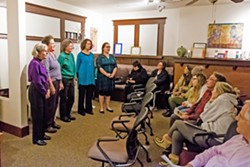 IN REMEMBRANCE At Hospice SLO County's annual Paws to Remember ceremony on Dec. 10, the Threshold Singers sang calming musical numbers for grieving pet owners. - PHOTO BY JAYSON MELLOM