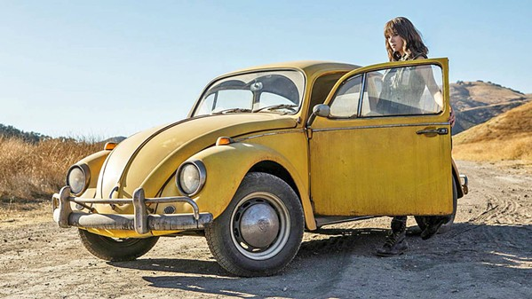 BETTER BUG Charlie (Hailee Steinfeld) discovers an old VW Bug in a junkyard that turns out to be Bumblebee (voiced by Dylan O'Brien), a Transformer bot in hiding, in Bumblebee. - PHOTO COURTESY OF ALLSPARK PICTURES
