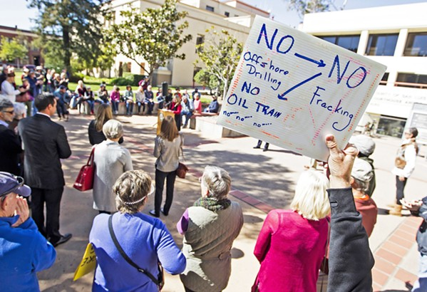 SPEAKING UP A crowd protests the oil and gas industry in SLO County. A recent U.S. Bureau of Land Management report shows that thousands of residents and organizations registered opposition to fracking public lands this past fall. - FILE PHOTO BY JAYSON MELLOM