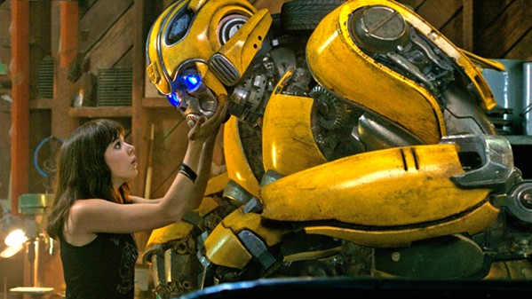 DYNAMIC DUO Charlie (Hailee Steinfeld) befriends Bumblebee, an Autobot disguised as a VW Beetle in a junkyard, in the Transformers prequel Bumblebee. - PHOTO COURTESY OF ALLSPARK PICTURES