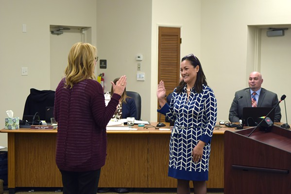 NEW FACES Lan George takes the oath of office after being appointed to fill a vacant seat on the Arroyo Grande City Council on Jan. 8. The day before, the Grover Beach City Council voted to appoint Desi Lance to its own vacant seat. - PHOTO BY AIDAN MCGLOIN