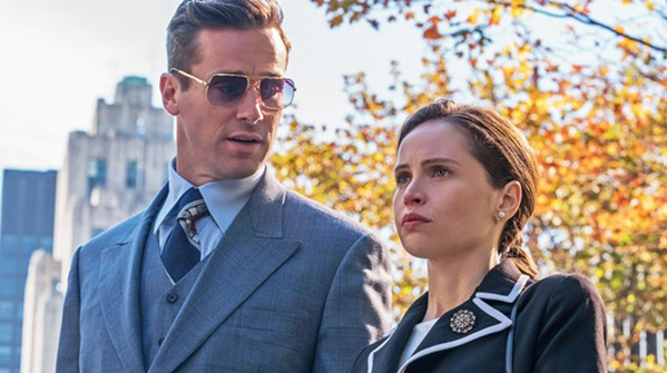 THE MAN BEHIND THE WOMAN Armie Hammer (left) stars as Martin Ginsburg, husband to now-Supreme Court Justice Ruth Bader Ginsburg (Felicity Jones, right). - PHOTOS COURTESY OF AMBLIN PARTNERS