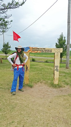 HALFWAY Arroyo Grande's Ben Walther walked 3,600 miles across the country in 2017 after surviving cancer. Here he is near Lebanon, Kansas, at the geographical center of the U.S. - PHOTO COURTESY OF BEN WALTHERS