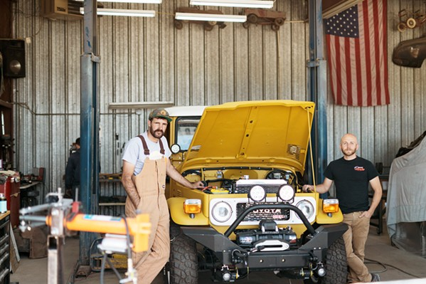 CREATED FOR CONSERVATION Nathan Stuart (left) and Steven Ploog (right) rebuilt two Toyota Landcruisers to run on biodiesel fuel. They plan to drive them through Central America in May for a film series that will document conservation projects in the region. - PHOTO COURTESY OF STEVE PLOOG