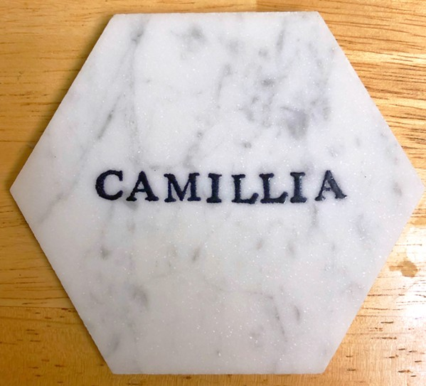 YOUR DRINK HERE New Times Editor Camillia Lanham uses this coaster she got at a cousin's wedding every day. It's on her nightstand. - PHOTO BY GLEN STARKEY