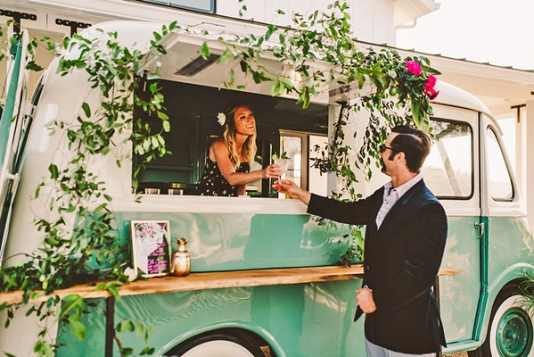 CUSTOMIZED If you're looking for a vintage vibe for your wedding, Christina Joslin has the hookup to serve your booze from a retro vehicle. - PHOTO COURTESY OF MICHELLE ROLLER