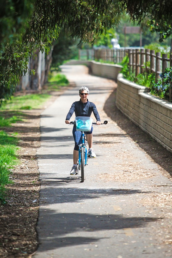 RIDE ON Melissa Trinidad goes for a spin on the best bike trail in the county—yes, it's always been that paved path that takes riders from city to sea: The Bob Jones Trail. - PHOTO BY JAYSON MELLOM