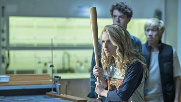 MURDEROUS FUN Tree Gelbman (Jessica Rothe, foreground) learns how she's become trapped in a time loop, reliving her murder over and over, in the satirical sequel, Happy Death Day 2U. - PHOTO COURTESY OF BLUMHOUSE PRODUCTIONS