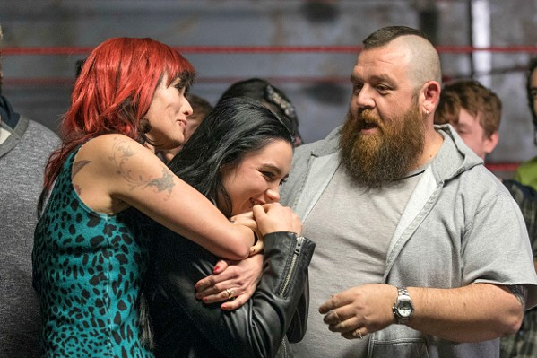 """FAMILY TIES Saraya """"Paige"""" Bevis (Florence Pugh, center) feels the love from her wrestling parents, Julia (Lena Headey) and Patrick (Nick Frost). - PHOTOS COURTESY OF METRO-GOLDWYN-MAYER"""