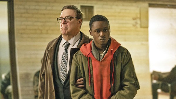 ENSLAVEMENT Ten years into an alien occupation, collaborator Officer Mulligan (John Goodman, left) believes Gabriel (Ashton Sanders), a young man whose brother was part of the alien resistance, may be a threat to his alien masters. - PHOTOS COURTESY OF DREAMWORKS