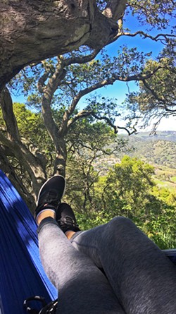 ENJOY NATURE Setting up a hammock is relatively easy, and the best part is being able to sit or lie in your hammock and enjoy being surrounded by nature. - PHOTOS BY KAREN GARCIA