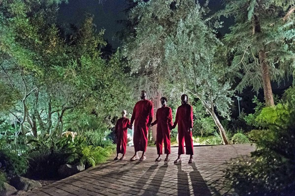 HANDS ACROSS AMERICA Evil doppelgängers menace a family in writer-director Jordan Peele's new film Us, but like his debut Get Out, this film has more on its mind than mere horror. - PHOTO COURTESY OF MONKEYPAW PRODUCTIONS
