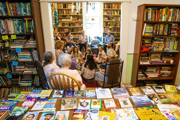 GIFTING BOOKS Liz Krieger has opened her home to schools, teachers, and, most importantly, students in order to give away donated books. - PHOTOS BY JAYSON MELLOM