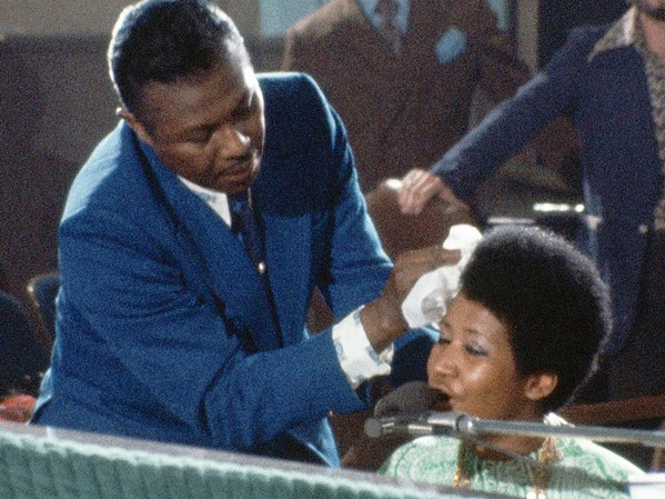 DIVINE As Aretha Franklin sings, her father, Rev. C.L. Franklin, wipes the perspiration from her face in this moving concert documentary filmed in 1972. - PHOTOS COURTESY OF 40 ACRES & A MULE FILMWORKS