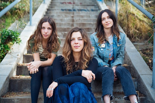 GET WILD The Wild Reeds—Kinsey Lee, Mackenzie Howe, and Sharon Silva—bring their harmony vocals to SLO Brew Rock on May 8, in support of their third album, Cheers. - PHOTO COURTESY OF THE WILD REEDS
