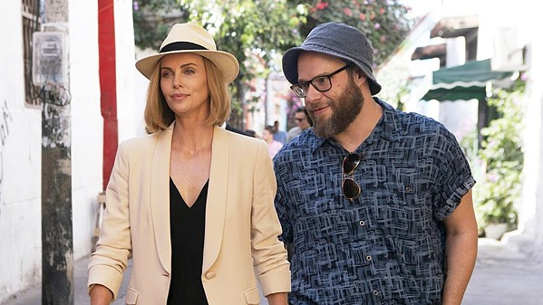 BEAUTY AND THE ... FLARSKY? Frumpy journalist Fred Flarsky (Seth Rogen, right), reunites with his first crush—beautiful, ambitious, but lonely presidential hopeful Charlotte Field (Charlize Theron)—who hires him as her speechwriter, in Long Shot. - PHOTO COURTESY OF DENVER AND DELILAH PRODUCTIONS