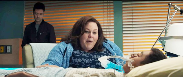 MIRACLE When her son, John (Marcel Ruiz), falls through lake ice and dies, Joyce (Chrissy Metz, center) prays for a miracle under the watchful eye of local pastor Jason Noble (Topher Grace), in Breakthrough. - PHOTO COURTESY OF FOX 2000 PICTURES
