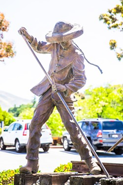 STATUE DEBATE All of SLO's existing public statues depict symbolic subjects, like this Chinese rail worker, as opposed to specific historic individuals. In July, the City Council will discuss its monument policy. - PHOTO BY JAYSON MELLOM