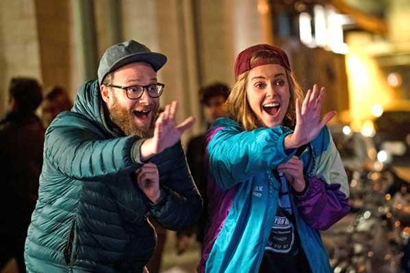 PARTY Frumpy journalist Fred Flarsky (Seth Rogen, left), reunites with his first crush—beautiful, ambitious, but lonely presidential hopeful Charlotte Field (Charlize Theron)—who hires him as her speechwriter, in Long Shot. - PHOTO COURTESY OF DENVER AND DELILAH PRODUCTIONS