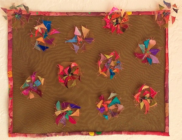 LEFTOVER Instead of buying new supplies, fiber artist Kate Froman is trying to use all of her leftover fabric scraps to make pieces like A Rare Desert Bloom. - PHOTO COURTESY OF KATE FROMAN