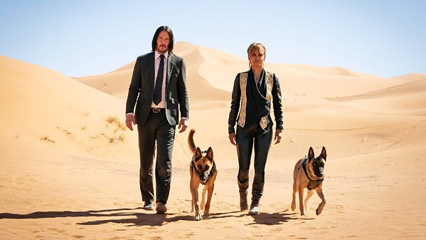REDEMPTION BOUND Assassin John Wick finds himself on the run with a $14 million bounty on his head, reluctantly helped by another dog-loving assassin, Sofia (Halle Berry), and her two badass Belgian Malinois dogs. - PHOTOS COURTESY OF SUMMIT ENTERTAINMENT