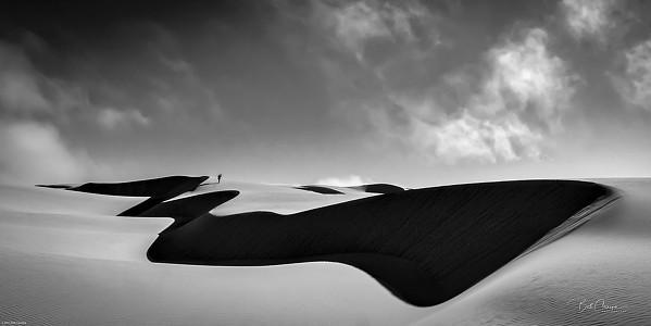 PERSPECTIVE A lone figure walks the Oceano Dunes in San Luis Obispo photographer Bob Canepa's piece, Beautiful Solitude. - PHOTO COURTESY OF BOB CANEPA