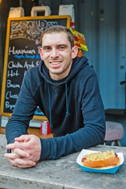 LOCAL BIZ Nick Regalia, 32, of SLO, started his street food business, Zen Dog, in 2016, and today he's the only vendor of his kind out in downtown SLO late at night, at McCarthy's Irish Pub. - PHOTO BY JAYSON MELLOM