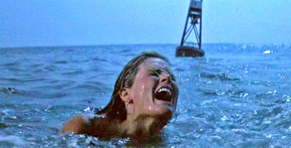 DA-DA-DA! A skinny dipper is attacked by a massive great white shark in the opening of the 1975 classic, Jaws, screening in Galaxy Theaters - PHOTO COURTESY OF UNIVERSAL PICTURES
