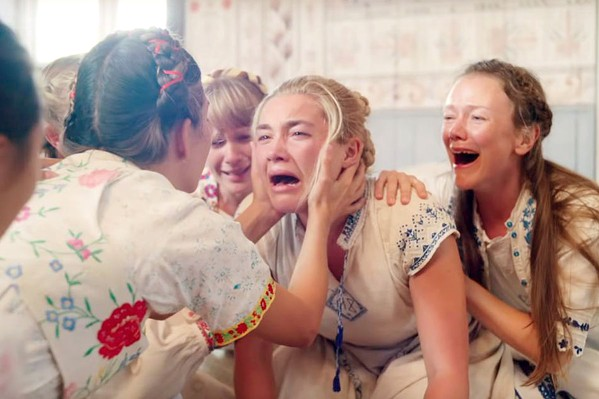 DARK SUMMER Dani (Florence Pugh, center) travels to Sweden for a festival that turns out to be run by an evil pagan cult, in the new horror film Midsommar. - PHOTO COURTESY OF B-REEL FILMS