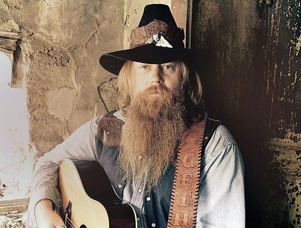 ALL-AMERICAN Gethen Jenkins—a U.S. Marine vet who was West Virginia-born but raised in an Alaskan Indian village—brings his original music to Sweet Springs Saloon on July 11. - PHOTO COURTESY OF GETHEN JENKINS