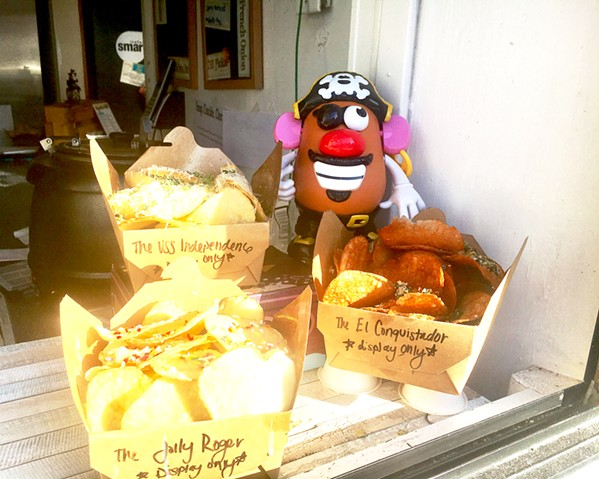 "POSING POTATO HEAD Mr. Potato Head doesn't just pose with Chipwrecked's chips. He has made an appearance in many of owner Sarah Paddack's photos, including taking the forefront of several snapshots from a recent trip to Europe: ""He goes everywhere with us now,"" Paddack said. ""We just took him to the drive-in the other night."" - PHOTOS BY BETH GIUFFRE"