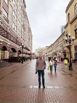 EXPLORING Here I am on Arbat Street, a long cobblestone pedestrian alley, home to shops, artists, and cafes. - PHOTO COURTESY OF PETER JOHNSON