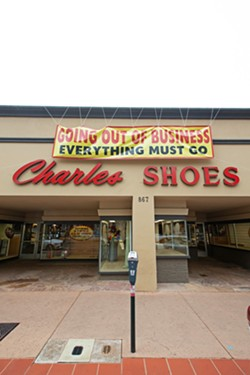 CLOSING WOES Charles Shoes closed in August after more than 50 years in business. Though the store's closure can't be blamed on any failings of the city or owners, its loss is representative of a greater issue that some say is deterring longtime residents from making the trip downtown. - PHOTO BY JAYSON MELLOM