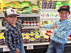 """YOUNG ENTREPRENEURS Twisselman boys Taylor, left, and Aidan, right, spot their family's Best Ever Salsa Company jars on the local grocery shelves. Aidan, nicknamed """"Salsa Man,"""" loves being part of the family business. - PHOTO COURTESY OF KARLI TWISSELMAN"""