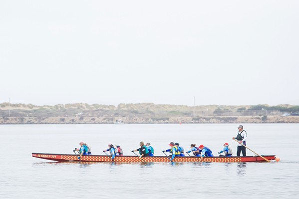 IN THE SAME BOAT The Central Coast Dragon Boating Association offers several boat trainings and activities each week in Morro Bay, for a range of skill levels. The nonprofit was founded in 2007 by a group of breast cancer survivors, and it's grown to more than 100 members today. - PHOTOS BY JAYSON MELLOM
