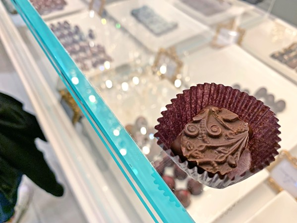 SWEET TREATS Sheila Kearns Chocolate & Confections was sampling their milk, dark, and bourbon chocolate (pictured here) treats. - PHOTO BY CAMILLIA LANHAM