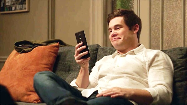 "PHONER Adam Devine is Phil, a lonely tech writer whose new A.I. operating system named Jexi (voiced by Rose Byrne) gives him the confidence he needs to make friends ... until ""she"" gets jealous, in Jexi. - PHOTO COURTESY OF CBS FILMS"