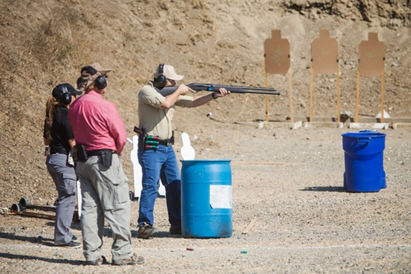 TARGET PRACTICE Instructors accompany a gun club member who's honing his rifle skills on one of SLOSA's 12 ranges. - PHOTO BY JAYSON MELLOM
