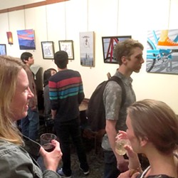 CAFé MEETS GALLERY Art After Dark attendees sip wine and enjoy a group show at Linnaea's Cafe. Owner Marianne Orme said she moves tables and provides an artist reception to turn her café into an art-focused space during this monthly event. - PHOTO COURTESY OF MARIANNE ORME