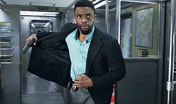 MAN ON A MISSION Chadwick Boseman stars as embattled NYPD Detective Andre Davis, who after two fellow officers are killed, shuts down Manhattan to search for the cop killers but instead discovers a conspiracy, in 21 Bridges. - PHOTO COURTESY OF HUAYI BROTHERS