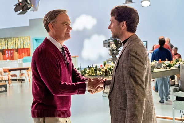 LOOK FOR THE HELPERS Beloved children's television host Mr. Rogers (Tom Hanks, left) teaches cynical journalist Lloyd Vogel (Matthew Rhys) the meaning of compassion and forgiveness, in A Beautiful Day in the Neighborhood. - PHOTO COURTESY OF TRISTAR PICTURES