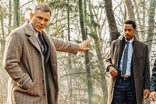 HE'S ON THE CASE Renowned detective Benoit Blanc (Daniel Craig, left) helps Lt. Elliott (LaKeith Stanfield) search for clues to the mystery of crime novelist Harlan Thrombey's death. - PHOTO COURTESY OF LIONSGATE
