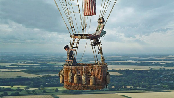 GET HIGH In 1862, Amelia Wren (Felicity Jones) and scientist James Glaisher (Eddie Redmayne) take flight in a gas balloon to attempt to fly higher than anyone in history, The Aeronauts. - PHOTO COURTESY OF AMAZON STUDIOS