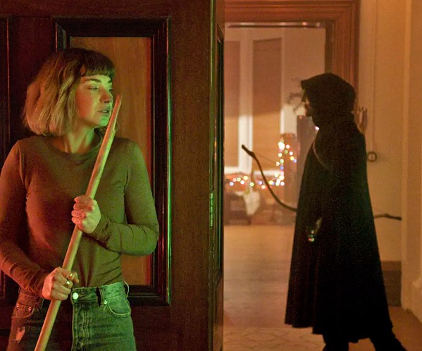ALL THROUGH THE HOUSE Imogen Poots stars as Riley (left), a college co-ed stalked by a killer over Christmas break, in Black Christmas, screening exclusively at Park Cinemas. - PHOTO COURTESY OF UNIVERSAL PICTURES